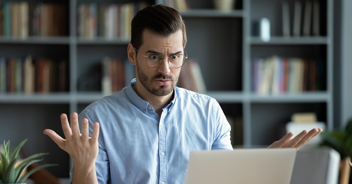 man confused at computer