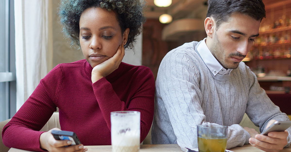 couple staring at phones